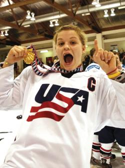 Sarah Erickson celebrates a gold-medal victory at the IIHF World Women's Under-18 Championship.