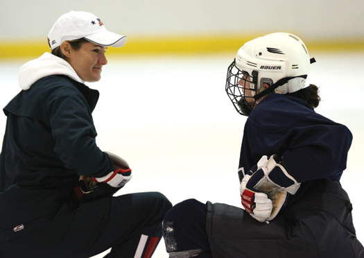 Michele Amidon, director of women's hockey operations for USA Hockey, talks with Olympian Kristin King during  a training camp in Ann Arbor, Mich.