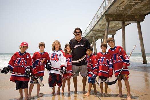 LA Hockey Club members Joey Thielen, Robert Jacobson, Keoni Texeira, Tara Turcotte, Aaron Aragon, Evan Somoza and Vincent de Mey join George Parros for a splash near the pier at Hermosa Beach, Calif.