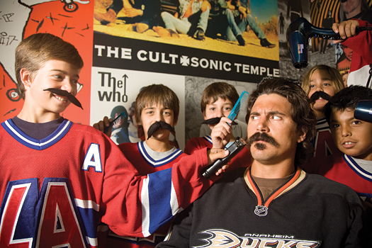 Just a little off the top and sides for Anaheim Ducks forward George Parros, who is a little concerned about letting  Vincent de Mey, Evan Somoza and  Robert Jacobson near his famous mustache.
