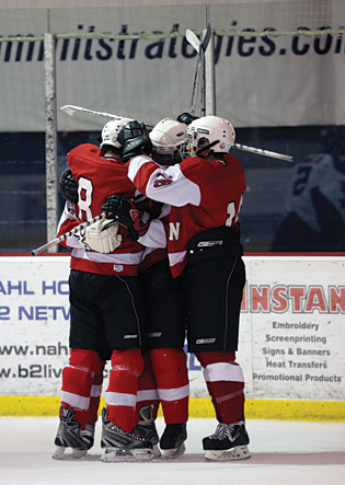 Team Wisconsin players celebrate a goal during the opening round of the Tier I 16 & Under tournament.