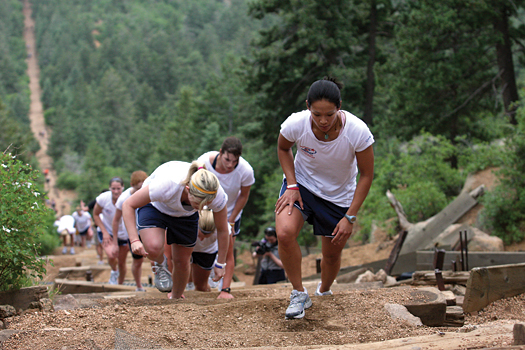 Two-time Olympic veteran Julie Chu leads the procession of players up the Manitou Springs Incline near Colorado Springs.