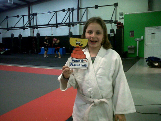 Verona Rose shows her Flat Stanley Cup how to joy-jitsu.