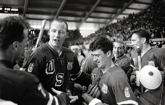Bob McVey and Bill Christian congratulate one another on the ice.