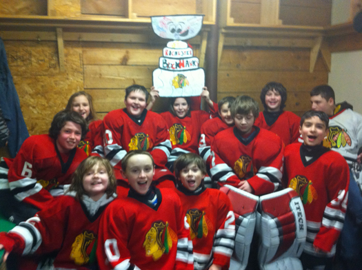 The Rochester Blackhawks Squirt 2 team traveled to Andover, N.H. to the Teddy Maloney Rink for a close 4 to 3 victory with their Flat Stanley Cup! The win clinched their 1st place standing for their division in the Granite State League!: Photo submitted by Lisa Saucier