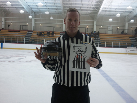 Flat Stanley Cup Ref tags along with Mike Sheeran to remind all refs to Wear A Shield (W.A.S). Sheeran was hit in the eye with a puck during a game: Photo submitted by Mike Sheeran