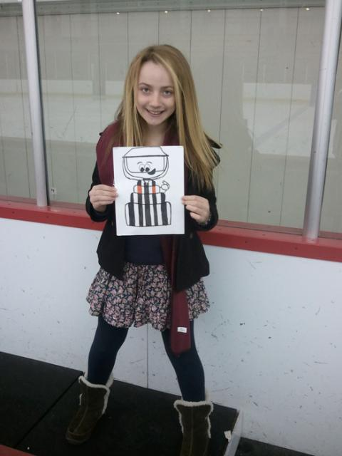 Mike Sheeran's daughter, a youth player, poses with Flat Stanley Cup Ref: Photo submitted by Mike Sheeran