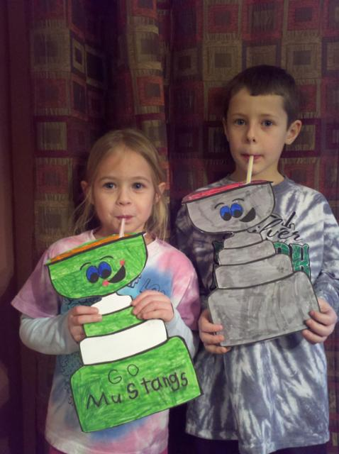 Brother and sister, Carson and Corinne Kostka sip a victory toast with Flat Stanley Cup.: Photo submitted by Brad Kostka