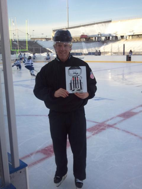 Flat Stanley Cup Ref joins Mike Sheeran again at the Whale Bowl in Rentchler Field to remind all officials to Wear A Shield (W.A.S).: -Photo submitted by Mike Sheeran