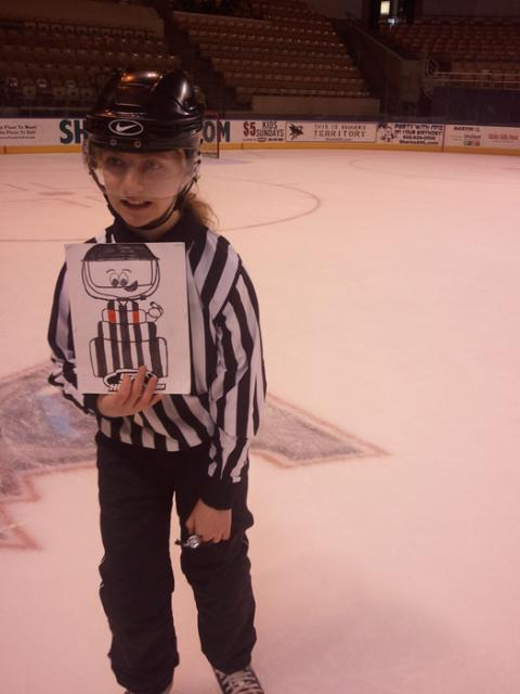 Meg Sheeran takes her Flat Stanley Cup with her to remind all refs young and old to Wear A Shield (W.A.S): Photo submitted by Mike Sheeran