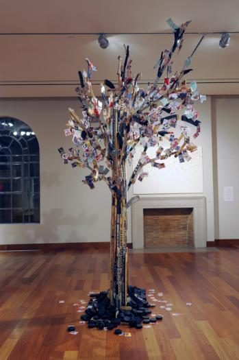 Maple LEAF Tree, recycled hockey sticks and hockey cards on wooden armature, height is 14 feet tall, 2008.