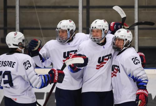 Bobby Brink (#25, far right) celebrates a goal with teammates in the Americans 6-3 preliminary round win over Russia.