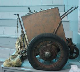 A homemade handcart from the 1960s is displayed inside the arena.