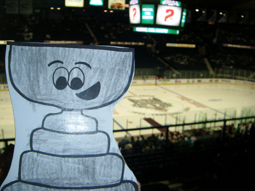 Flat Stanley Cup took in a Chicago Wolves game vs. the Hamilton Bulldogs.Despite a Wolves loss, Stanley still flashes his winning smile: Photo submitted by Patrick O'Hara