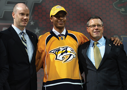 Seth Jones (middle) was the first African-American drafted in the first round.