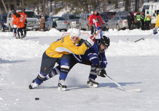 The competition on Dollar Lake is almost as much fun as the camaraderie off the ice whenever adult players lace up the skates.