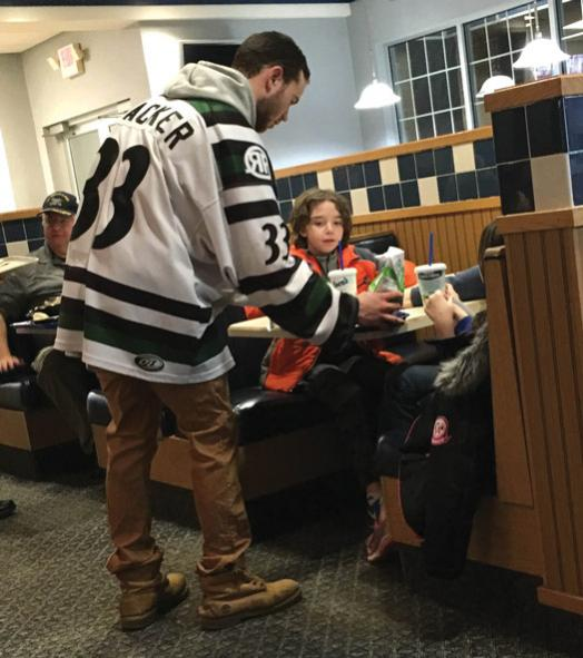 Like other USHL teams, the Cedar Rapids RoughRiders pride themselves on their community involvement. In return, the community supports players like Ben Blacker (33).