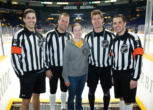 Young officials Jack Jourdan and Adam Gross took the ice for the national anthem in Charlotte, N.C., while Erika Greenen met NHL officials in Nashville, Tenn.