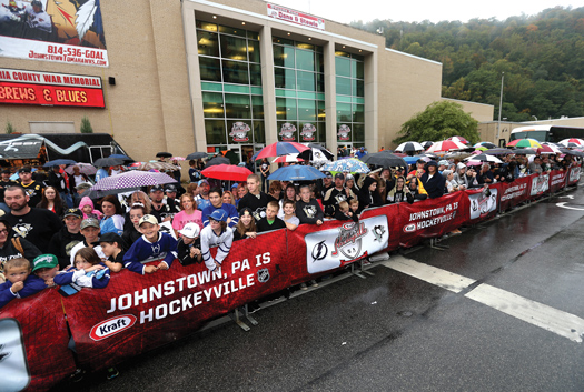 Even a steady rain couldn't keep       local hockey fans from greeting   the teams as they arrived for   their morning practices.