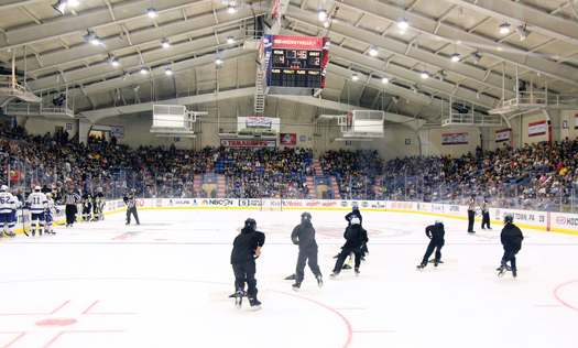 Local organizers worked hard to ensure that every youth hockey player who wanted to attend the game or practice session was given the opportunity. Some players were even enlisted to help with ice-scraping duties.