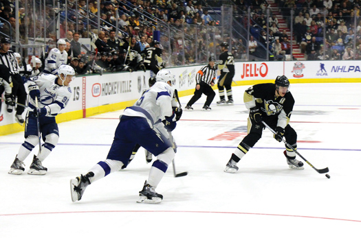 The Tampa Bay Lightning and   Pittsburgh Penguins thrilled   the capacity crowd with a    spirited preseason game that   was also broadcast live on the   NBC Sports Network.