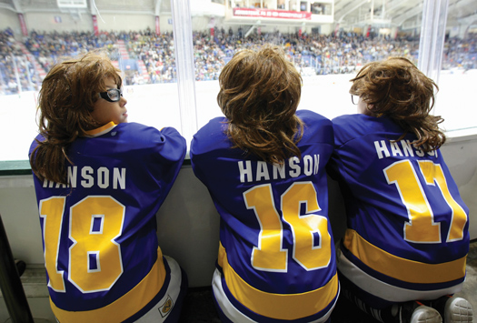 """Local youth hockey   players and fans of   the movie """"Slap Shot""""   got into the act as the   NHL® came to town for a      preseason game featuring               the Tampa Bay Lightning    and Pittsburgh Penguins."""