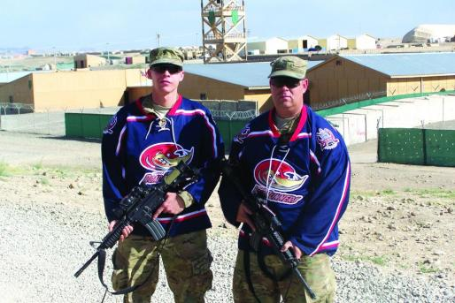 Army Spec. Lenard Chambers (left) and Sgt. 1st Class Roger Schneider continued to show their support for the NAHL's Topeka RoadRunners even while on deployment in Afghanistan.