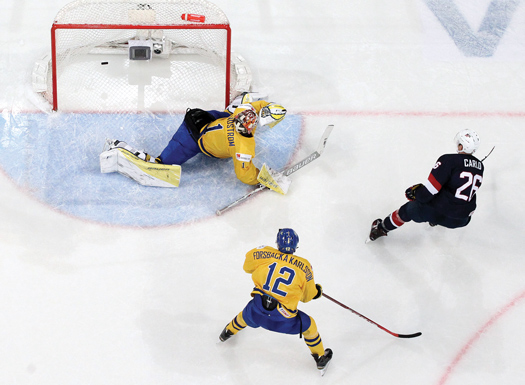After being frustrated by Swedish goaltender Linus Soderstrom in the preliminary round, the U.S. offensive attack sought revenge with an eight-goal effort in the bronze-medal game.