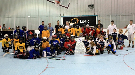 The Cayman Islands Youth Roller Hockey League shared the rink with Flat Stanley. Two of our Novice teams and two of our Atom teams are pictured here.  These kids LOVE Hockey!!: Photo submitted by Colleen Stoetzel & Ray Singh