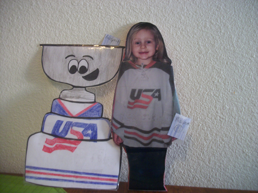 Flat Stanley Cup & a Flat Rahcel Elliot are ready to travel with their favorite ISU goalie, Erik Hudson, to Turkey for the World University Games at the end of Jan.: Photo submitted by Kristi Elliot