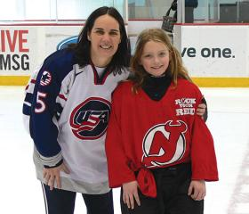 U.S. Olympian Colleen Coyne helps the New Jersey Devils open the game to more local female players during a special on-ice clinic.