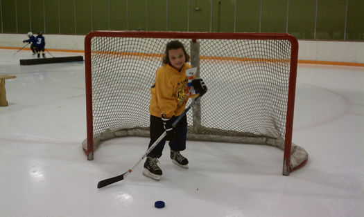Riley Kavanagh scores with a shot with Flat Stanley Cup: Photo submitted by USA Hockey