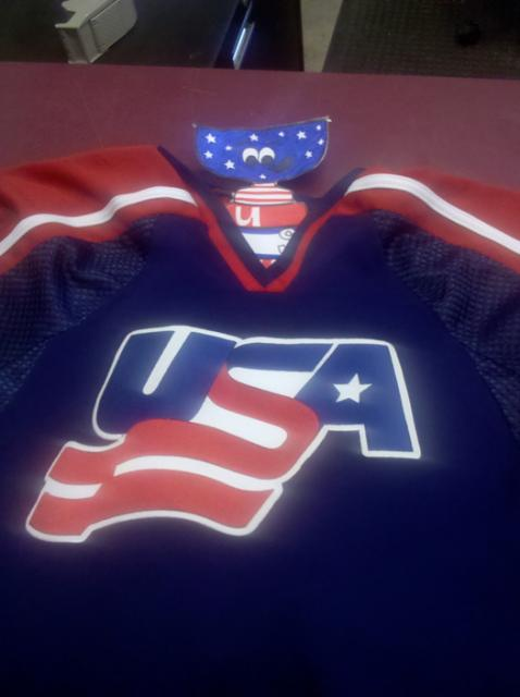 Stanley tries on an official USA Hockey Select jersey. He's ready to play.: Photo submitted by USA Hockey Magazine