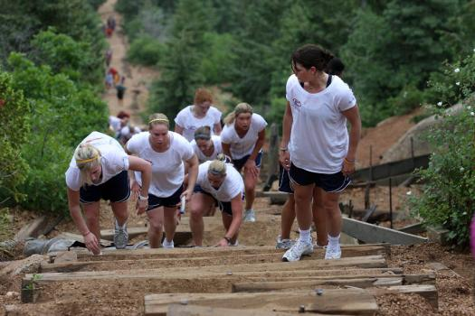 A small group sticks together through the steepest part of the incline