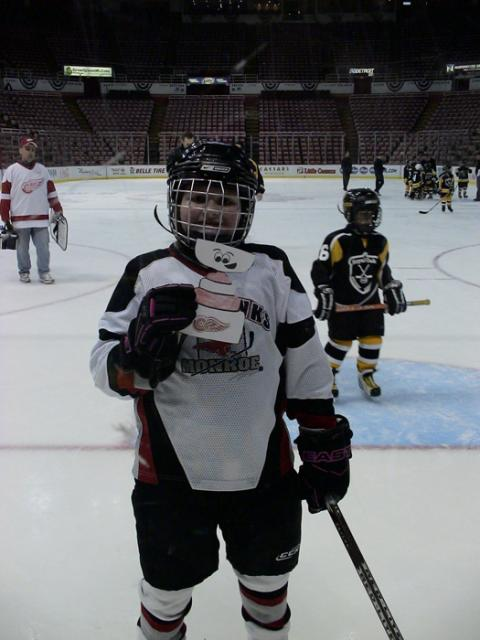 8-year-old Angela Bordeau with Flat Stanley after her mite team--the Monroe Ice Hawks--played at the Joe Louis Arena on January 26th.: Photo submitted by Debbie Bordeau