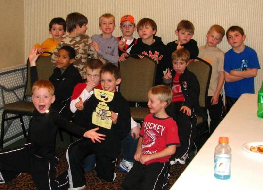 The Omaha Jr. Lancers Orange Mite Team take a break at their hotel with Flat Stanley Cup after coming away from the OAHE Capitals Mite Jamboree in Ft. Pierre, S.D. undefeated.: Photo submitted by Stacy Peterson