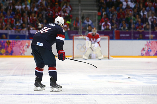 T.J. Oshie stares down Russian goaltender Sergei Bobrovsky prior to scoring another goal in the shootout victory at the 2014 Olympic Winter Games in Sochi, Russia.