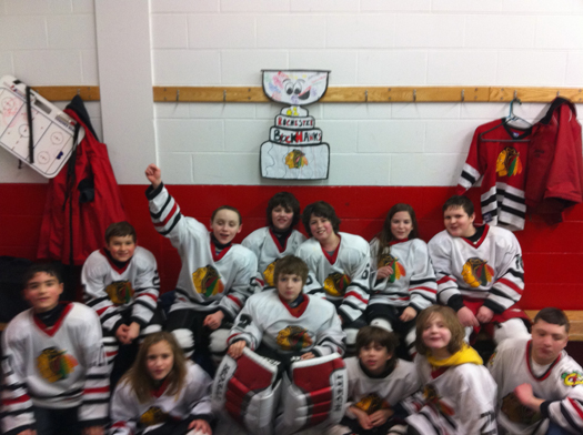 Flat Stanley Cup went to home ice with Rochester Blackhawks. For a 3 to 3 tie against our arch rivals the Dover Stars.: Photo submitted by Lisa Saucier