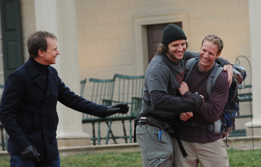 "Bates and Anthony Battaglia celebrate as they are greeted by ""Amazing Race"" host Phil Keoghan after crossing the finish line at Mt. Vernon, Va."