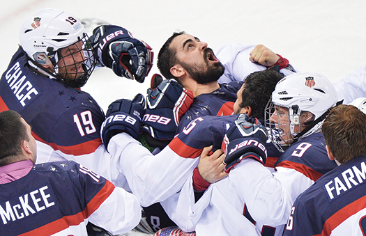 U.S. Sled Team goaltender Steve Cash is mobbed by his teammates after shutting out Russia, 1-0, in the gold-medal game. Cash surrendered only two goals in the tournament as the U.S. won its second straight Paralympic gold medal.