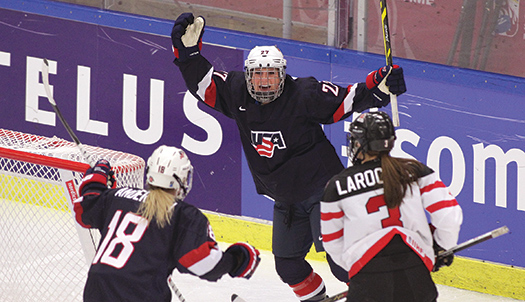 Stephanie Anderson, 18, and Annie Pankowski, 27, celebrate the first goal of the game as the U.S. Women's National Team stormed out to a 5-2 lead before holding on to win the gold-medal game, 7-5. The victory marked Team USA's fifth IIHF Women's World Cha