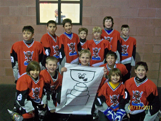 The New Mexico Amatuer Hockey Association Squirt Gold team with their Flat Stanley Cup after placing 2nd in the Durango, Colo. MLK tournament.: Photo submitted by Stepheny Kohlrust
