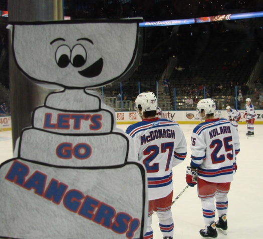 Flat Stanley looks on as Ranger players Ryan McDonagh (St. Paul, Minn.) and Chad Kolarik (Abington, Pa.) warmup for the game: Photo submitted by Bree Hicken