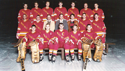 The 1984 All-Marine Hockey Team featured Jeff Kolcon, captain, and Michael Hernbrott, to his left.