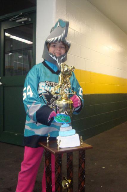 Midstate Junior Sharks #1 fan & Flat Stanley Cup pose with PeeWee 1's Division Championship Trophy: Photo submitted by Ellen Ganley