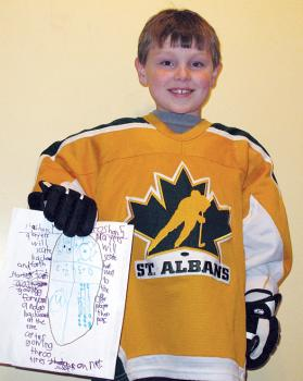St. Albans, Vt., Mite player Jimmy Pare displays his idea for an ADM practice plan.