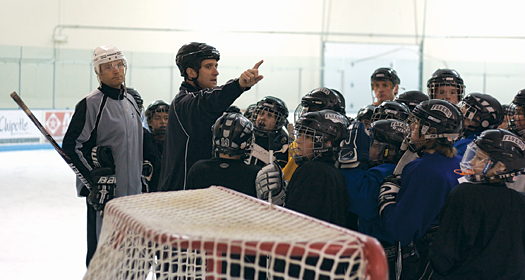 Former NHLers Curtis Leschyshyn (left) and Ken Klee (right) combine their professional experience with ADM principles to improve the skills of more than 100 players a week.