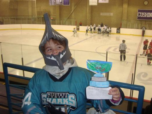 Flat Stanley Cup swims along with this Midstate Junior Shark: Photo submitted by Ellen Ganley