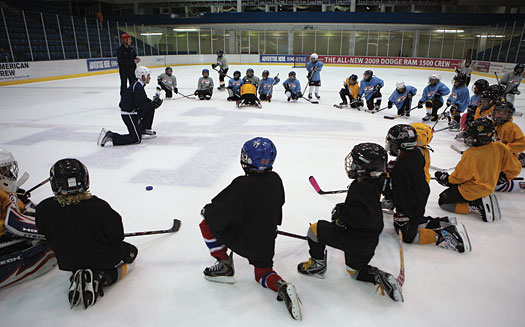 Coaches should plan practices that allow players to work on basic skills through a series of fun and competitive drills without pre-determined outcomes.