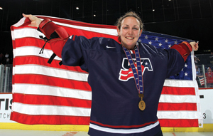 USA's Jessie Vetter #31 showing off her gold medal after a 3-2 OT win.